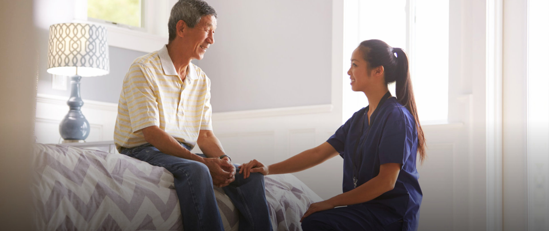 A patient looks happy facing to caregiver
